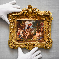 "© Licensed to London News Pictures. 28/06/2019. LONDON, UK. A technician presents ""Diana and Actaeon"" by Joachim Antonisz Wtewael (Est. GBP4-6m) at the preview of Sotheby's Old Masters sale which takes place at its New Bond Street galleries on 3 July.  Photo credit: Stephen Chung/LNP"