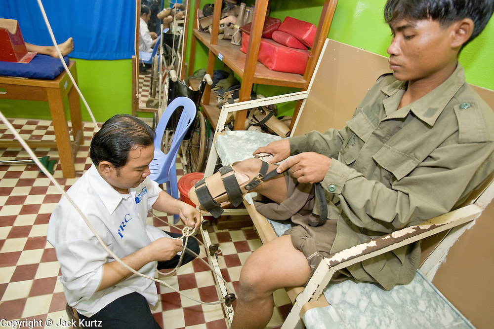 27 JUNE 2006 - SIEM REAP, CAMBODIA: HAM KOMSUP, 28, undergoes  physical therapy at Handicap International in Siem Reap, Cambodia.  He was a child soldier fighting the Khmer Rouge near the Thai border in 1993 when he stepped on a small plastic landmine which blew off his foot and part of his leg. He is now undergoing therapy at Handicap International. Handicap International helps Cambodians maimed by mines and unexploded ordinance as well as traffic accidents and disease adjust to a life without limbs. Cambodians are still wrestling with the legacy of the war in Vietnam and subsequent civil wars. At one time it was the most heavily mined country in the world and a vast swath of Cambodia, along the Thai-Cambodian border, is still mined. In 2004, more than 800 people were killed by mines and unexploded ordinance still found in the countryside.  Photo by Jack Kurtz