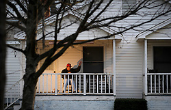 Michael Knox knows many of the people that pass by the Cornelius home where he has lived for 20 years. He always waves whether he knows them or not. Many wave back.<br />         Knox grew up in the Cornelius area not far from a Main St. that has changed so much right before his eyes. <br />         His front porch remains the same however, with him on it, waving at the world as it rushes by.<br />  photo by Laura Mueller www.lauramuellerphotography.com