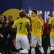 James Rodriguez, Colombia, celebrates after scoring the winning goal during the Columbia Vs Canada friendly international football match at Red Bull Arena, Harrison, New Jersey. USA. 14th October 2014. Photo Tim Clayton