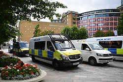© Licensed to London News Pictures. 09/08/2021. London, UK.  Anti-lockdown and anti-vaccination protestors converge on Television Studios in White City, West London on the mistaken belief the BBC are still based there. A large crowd tried to gain entranceto what is now an independent televisionstudio and private flats believing it was still the Corporation's main headquarters. Protestors confronted police in heated exchanges while ignoring what little still remains of the BBC's minimal presenceon the site, a large office in plain sight nextdoor. The news gathering element of the BBC has become synonymouswith 'fake-narrative' amongst certain groups andis increasinglytargeted by a growinganti 'mass-media' movement in the UK. Over a dozen police vans and a police helicopter were mobilised until protestors, having realised their mistake, vacated the area to march on Broadcasting House somemiles away in central London. Photo credit: Guilhem Baker/LNP