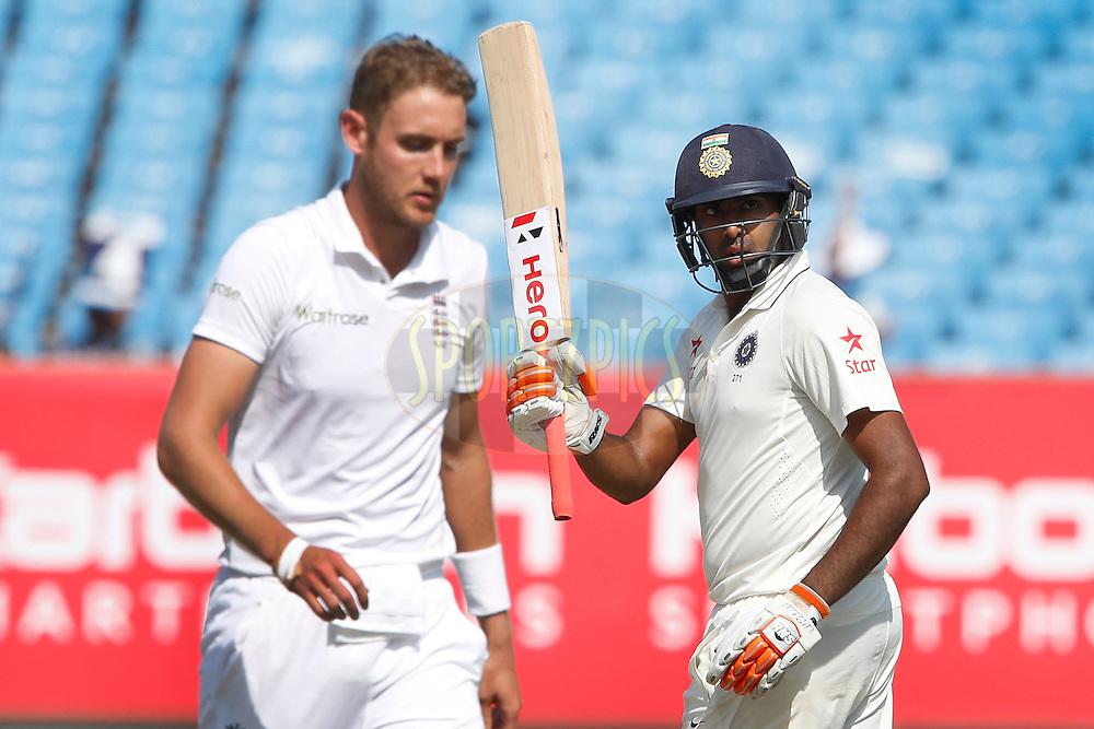 Ravichandran Ashwin of India raises his bat after scoring 50 runs during day 4 of the first test match between India and England held at the Saurashtra Cricket Association Stadium , Rajkot on the 12th November 2016.<br /> <br /> Photo by: Deepak Malik/ BCCI/ SPORTZPICS
