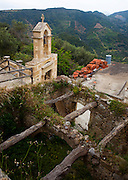 """Church tower and ruined rooof in the ancient Hellenic city of Polyrinia, Crete. The place name means """"many sheep"""" and it was the most fortified city in ancient Crete."""