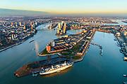 Nederland, Zuid-Holland, Rotterdam, 07-02-2018; Rotterdam-Zuid, Stadsdeel Feijenoord in winters avondlicht, bij zonsondergang. ss Rotterdam afgemeerd bij het Kaappark op Katendrecht, Maashaven. Zicht op Kop van Zuid, Nieuwe Maas, binnenstad.<br /> South Rotterdam, with former harbour quarter Katendrecht and ss Rotterdam.<br /> luchtfoto (toeslag op standard tarieven);<br /> aerial photo (additional fee required);<br /> copyright foto/photo Siebe Swart