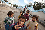 Brahim, centre, plays with a toy gun in Yayladagi refugee camp for Syrians in southern Turkey. 12/21/2012 Bradley Secker for the Washington Post