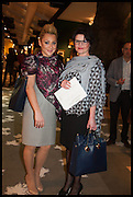 JOANNA GRIFFIN (L) and KINGA SAOULI SERGUEEV (R) at the preview of LAPADA Art and Antiques Fair. Berkeley Sq. London. 23 September 2014.