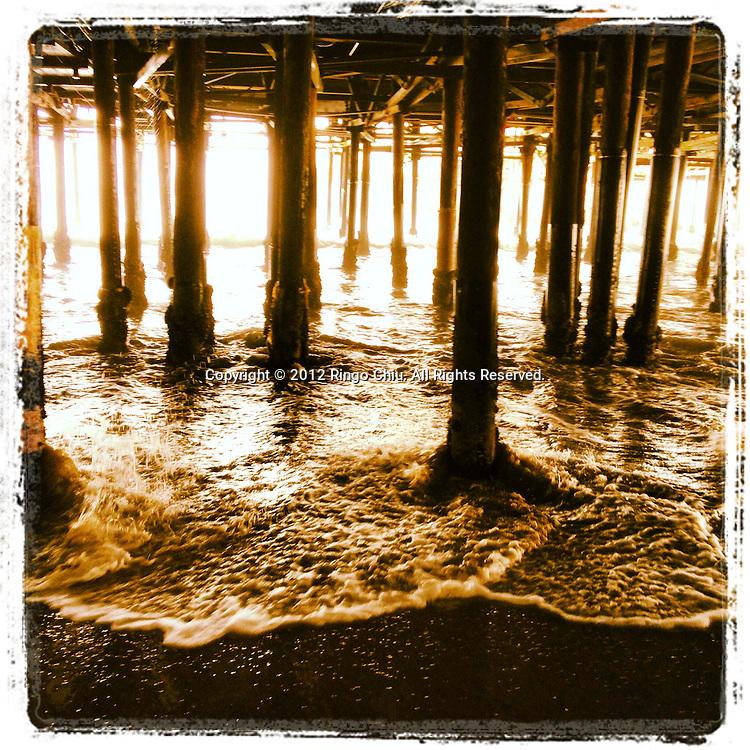Waves underneath the Santa Monica Pier in Santa Monica, California, USA. (Photo by Ringo Chiu/PHOTOFORMULA.com).