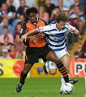Photo: Daniel Hambury.<br /> Queens Park Rangers v Ipswich. Coca Cola Championship.<br /> 09/08/2005.<br /> QPR's Gareth Ainsworth battles with Ipswich's Fabien Wilnis.