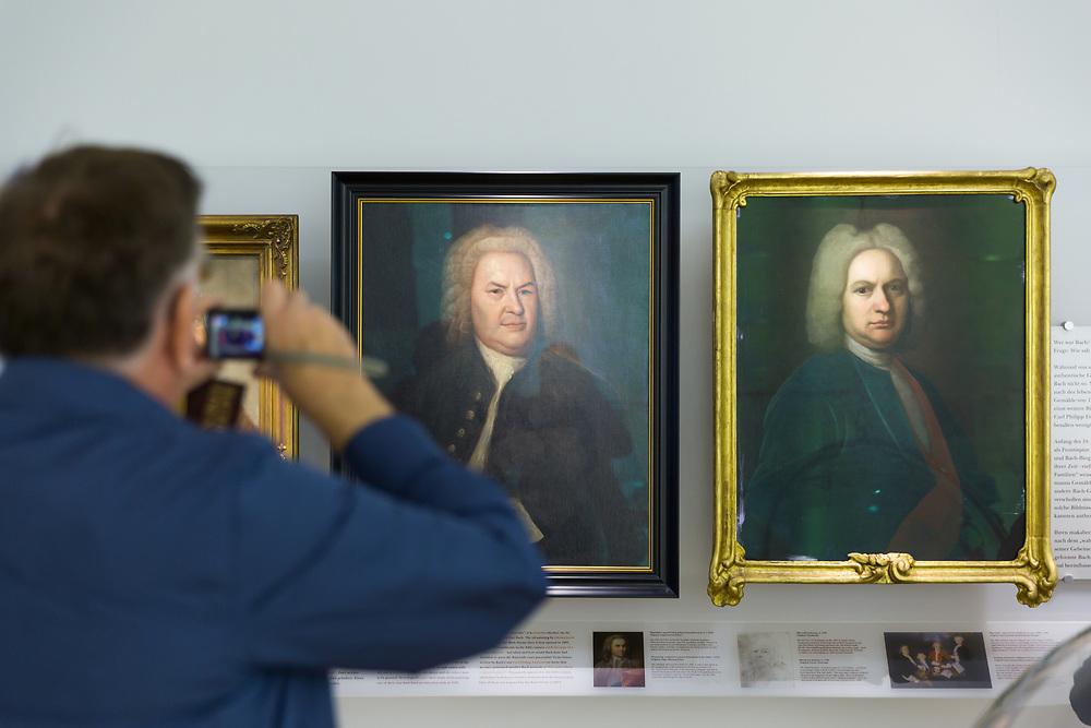 Jim Brueggemann '64 takes photos of paintings of Johann Sebastian Bach during a visit to the Bachhaus in Eisenach, Germany.