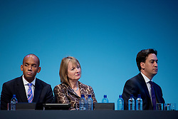 © London News Pictures. 23/09/2013 . Brighton, UK. L to R Shadow Business Secretary CHUKA UMUNNA, deputy party leader HARRIET HARMAN, and Labour Party leader ED MILIBAND, listen to Ed Balls deliver a speech on the British economy on day two of the Labour Party Annual Conference in Brighton. Photo credit : Ben Cawthra/LNP