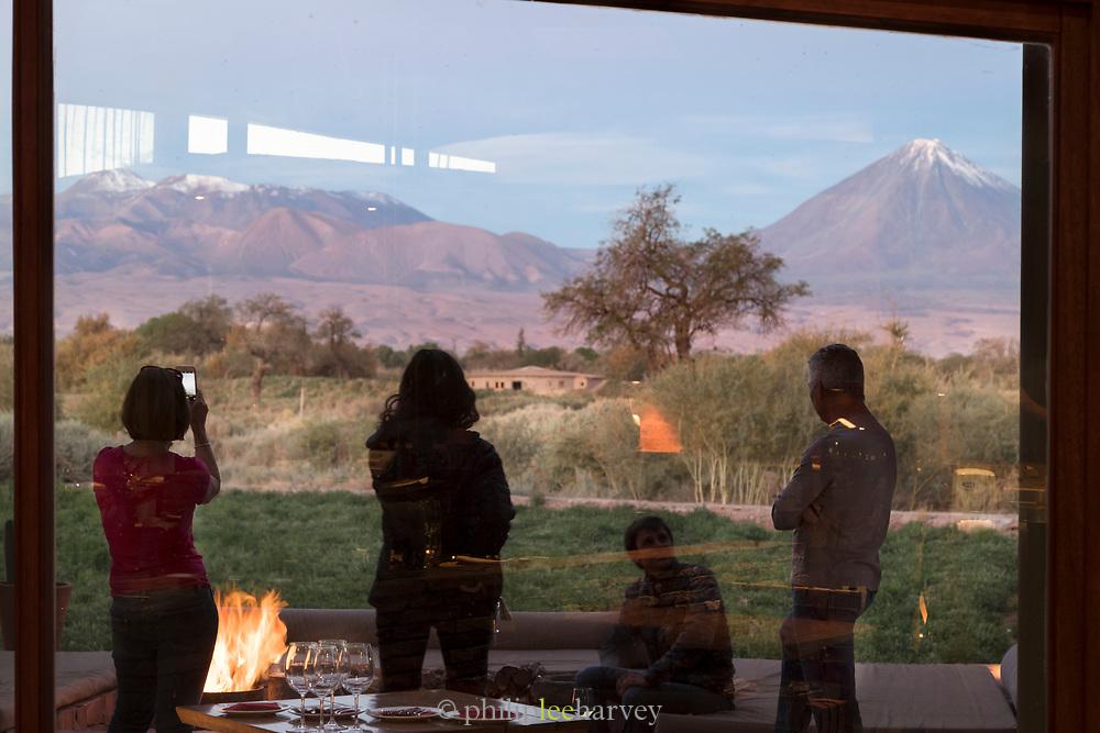 Tourists looking at Licancabur volcano from Tierra Atacama Hotel, San Pedro de Atacama, Chile