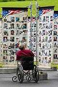 Scranton, Pennsylvania (September 8, 2018) -- A man looks at photos of American service members killed since 9/11 at a travelling memorial set up at McDade Park in Scranton. (Photo: Paul Weaver)