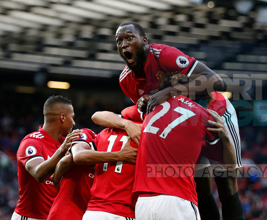 Romelu Lukaku of Manchester United celebrates with fourth goalscorer Anthony Martial of Manchester United during the premier league match at the Old Trafford Stadium, Manchester. Picture date 17th September 2017. Picture credit should read: Simon Bellis/Sportimage