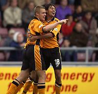 Photo: Richard Lane.<br />Northampton Town v Hull City. Nationwide Division Three. 04/10/2003.<br />Danny Allsopp celebrates his goal with Jason Price.