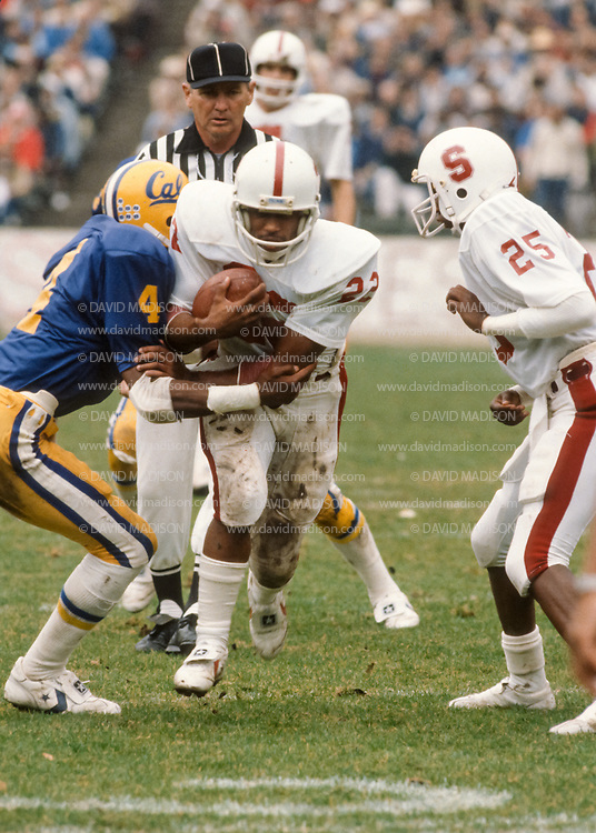 COLLEGE FOOTBALL:  Stanford vs Cal in the annual Big Game played on November 22, 1980 at Memorial Stadium in Berkeley, California.  Vincent White #22, Andre Tyler #25, John Elway #7 of Stanford; John Sullivan #4 of Cal.  Photograph by David Madison | www.davidmadison.com.
