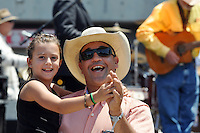Jacey Gonzales, 9, enjoys a dance with Jason Armendariz at Sunday's final Day of Champions at the California Rodeo Salinas.