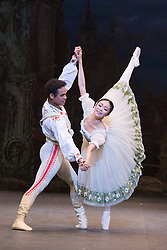 © Licensed to London News Pictures. 22/07/2014. London, England. Pictured: Shiori Kase as Swanilda and Yonah Acosta as Franz. Working stage rehearsal of Coppélia with the English National Ballet at the London Coliseum. With Shiori Kase as Swanilda and Yonah Acosta as Franz. Choreography by Ronald Hynd after Marius Petipa to music by Léo Delibes. Music performance by the Orchestra of the English National Ballet conducted by Gavin Sutherland. Photo credit: Bettina Strenske/LNP