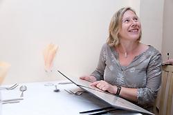 Woman ordering a meal off a menu at a Polish restaurant,