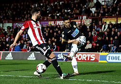 Kaiyne Woolery of Bolton Wanderers crosses the ball past Maxime Colin of Brentford - Mandatory by-line: Robbie Stephenson/JMP - 05/04/2016 - FOOTBALL - Griffin Park - Brentford, England - Brentford v Bolton Wanderers - Sky Bet Championship