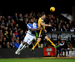 Greg Taylor of Cambridge United heads clear from Ellis Harrison of Bristol Rovers - Mandatory byline: Neil Brookman/JMP - 07966 386802 - 30/10/2015 - FOOTBALL - The Abbey Stadium - Cambridge, England - Cambridge United v Bristol Rovers - Sky Bet League Two