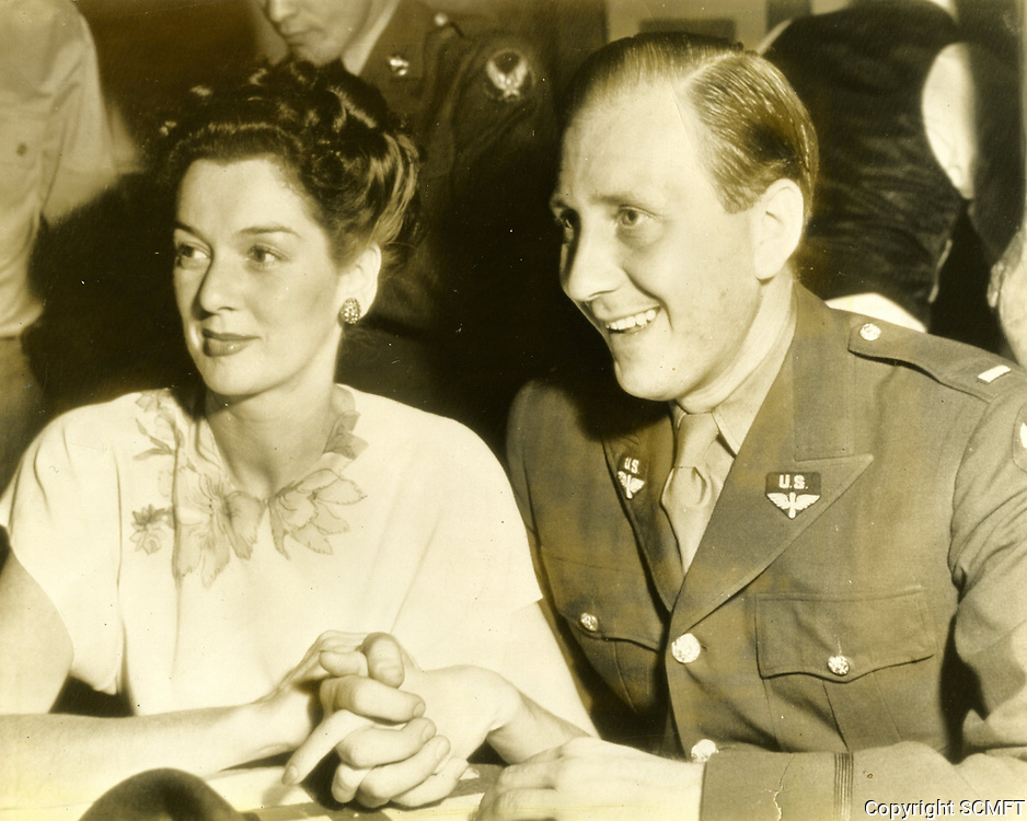 1942 Actress, Rosalind Russell and her husband, Freddie Brisson, watch as servicemen enjoy themselves at the Hollywood Canteen.