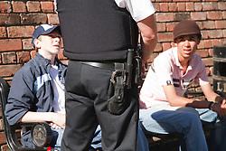 Policeman talking to group of teenage boys.
