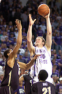 Kansas State center Tyler Hughes (C) scores over Colorado's Martane Freeman (L) during the second half of the Wildcats 72-60 win over the Buffaloes at Bramalage Coliseum in Manhattan, Kansas, February 18, 2006.