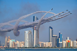 Al Fursan the aerobatics demonstration team of the United Arab Emirates Air Force display along Corniche waterfront in Abu Dhabi United Arab Emirates