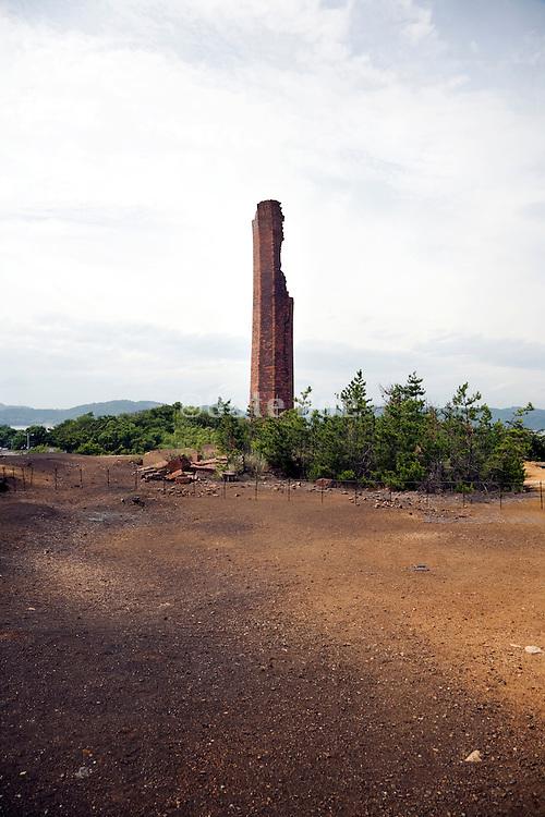 old falling apart industrial chimney