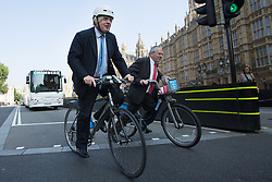 © licensed to London News Pictures. London, UK 04/09/2013. Mayor of London Boris Johnson (left) and Commissioner of Transport for London Sir Peter Hendy leaving a photocall after unveiling plans to tackle HGV blind spots to improve cycle safety in London on Tuesday, September 4, 2013. Photo credit: Tolga Akmen/LNP