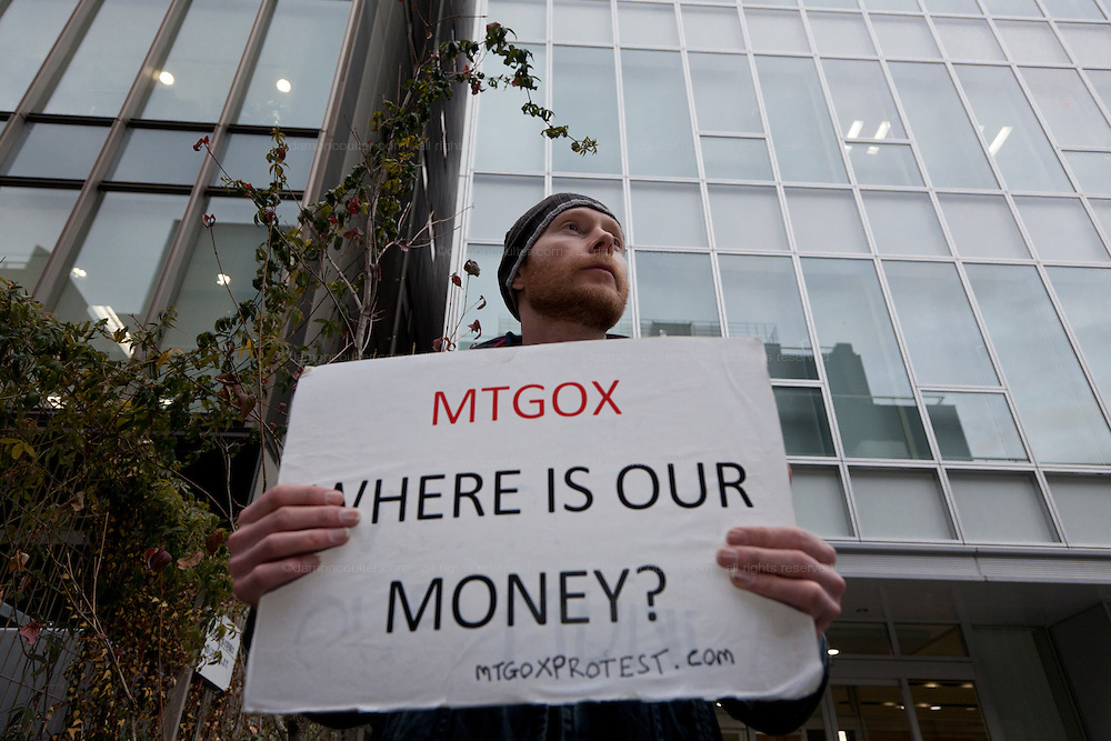 Bitcoin trader, Kolin Burges, from the United Kingdom, protests in front of the abandoned offices of Tokyo-based Bitcoin exchange, Mt. Gox. Shibuya, Tokyo, Japan. Friday February 28th 2014. Mr Burges flew to Japan to personally confront the trading company over his inabilty to withdraw over 260,000 USD worth of the electronic currency. Mt. Gox officially filed for bankruptcy protection on February 28th 2014