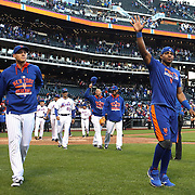 Wilmer Florew, (left) and Yoenis Cespedes, (right), and the New York Mets team celebrate with their fans after closing out the regular season with a 1-0 win over the Washington Nationals  during the New York Mets Vs Washington Nationals MLB regular season baseball game at Citi Field, Queens, New York. USA. 4th October 2015. Photo Tim Clayton