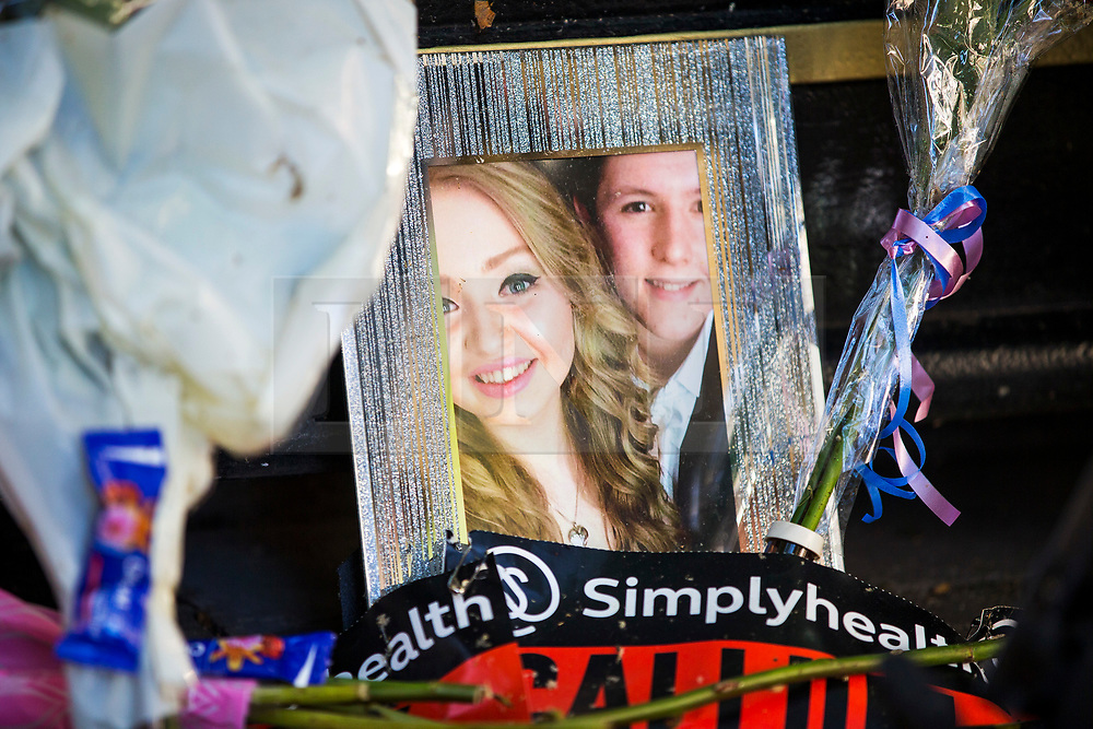 © Licensed to London News Pictures. 22/05/2018. Manchester UK. Picture shows a photograph left if St Ann's square this morning of Chloe Rutherford age 17 & Liam Curry age 19 who where killed in the Manchester Arena attack. Today marks the first anniversary of the Manchester Arena bombing. 22 people died when Salman Abedi detonated a bomb at an Ariana Grande concert. Photo credit: Andrew McCaren/LNP