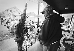 17 Feb 2015. New Orleans, Louisiana.<br /> Mardi Gras Day. Walking with Skeletons. <br /> Celebrating Fat Tuesday with a neighbor. The Skeleton Krewe meets before dawn beside a cemetery in Uptown New Orleans. They then walk several miles to the French Quarter to celebrate Mardi Gras Day.<br /> Photo; Charlie Varley/varleypix.com
