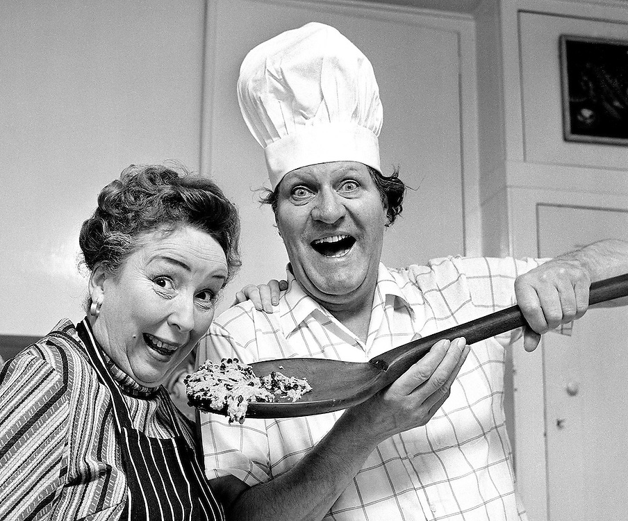 British comedian Tommy Cooper and his wife Gwen seen at their home in London, England making a Christmas cake. Photographed by Terry Fincher