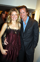 CHRISTOPHER GETTY and LAINEY SHERIDAN-YOUNG at an exhibition of photographs by Matthew Mellon entitled Famous Feet - featuring well known people wearing shoes from Harrys of London, held at Hamiltons Gallery, Carlos Place, London on 22nd November 2004.<br /><br />NON EXCLUSIVE - WORLD RIGHTS