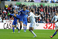 Swansea city's Michu (9) is challenged by Chelsea's Branislav Ivanovic (l) .  Barclays Premier league, Swansea city v Chelsea at the Liberty Stadium in Swansea, Swansea, South Wales on Saturday 3rd November 2012. pic by Andrew Orchard, Andrew Orchard sports photography,