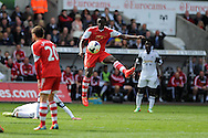 Southampton's Victor Wanyama © has a shot blocked. Barclays Premier league match, Swansea city v Southampton at the Liberty stadium in Swansea, South Wales on Saturday 3rd May 2014.<br /> pic by Andrew Orchard, Andrew Orchard sports photography.