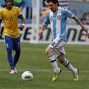Lionel Messi, Argentina, in action watched by Neymar, Brazil, during the Brazil V Argentina International Football Friendly match at MetLife Stadium, East Rutherford, New Jersey, USA. 9th June 2012. Photo Tim Clayton