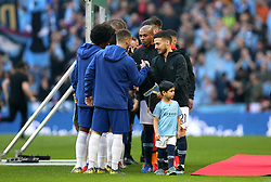 Chelsea players and Manchester City players shake hands prior to the beginning of the Carabao Cup Final at Wembley Stadium, London.