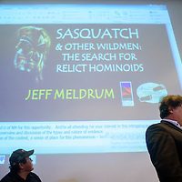 UNM-Gallup executive director Christopher Dyer, right, introduces other presenters during a special bigfoot lecture at UNM-G Thursday.