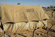 The Breidjing Refugee Camp, Eastern Chad on the Sudanese border shelters 30,000 people (in tents provided by the UNHCR: United Nations High Commission for Refugees) who have fled their homes in Darfur, Sudan. Food is distributed free of charge by the United Nations WFP (World Food Program). (Supporting image from the project Hungry Planet: What the World Eats.)