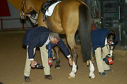 Checking boots<br /> World Cup Final Jumping - Las Vegas 2003<br /> © Hippo Foto - Dirk Caremans