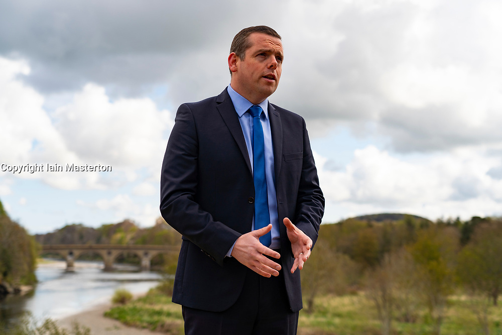 Coldstream, Scotland, UK. 29 April 2021. Douglas Ross, leader of the Scottish Conservative party makes speech in Coldstream in the Scottish Borders calling on pro-UK voters to use their peach party list votes to save Scotland's recovery and stop another referendum.  Pic; Douglas Ross meets supports and the media at Henderson Park in Coldstream which stands on the Scottish-English border.  Iain Masterton/Alamy Live News