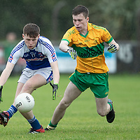 St. Senan's Kilkee's Dylan Russell gets the ball whie tackled by O'Curry's Glenn Mullaney