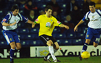 Photo: Paul Greenwood.<br />Bury v Hereford United. Coca Cola League 2. 30/01/2007. Hereford's Ben Smith, centre, holds off John Fitzgerald, left,
