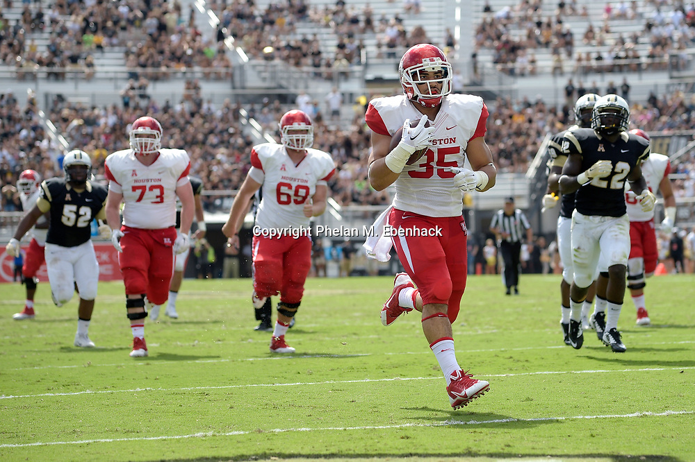 Houston running back Kenneth Farrow (35) rushes for a 26-yard touchdown during the first half of an NCAA college football game against Central Florida in Orlando, Fla., Saturday, Oct. 24, 2015. (Photo by Phelan M. Ebenhack)