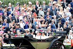 Racegoers look on as The Countess of Wessex and the Duchess of Sussex arrive during day one of Royal Ascot at Ascot Racecourse