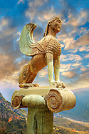 Large Sphinx of Naxos sitting on an Ionic column circa 560 B.C. Delphi Archaeological Museum. .<br /> <br /> If you prefer to buy from our ALAMY PHOTO LIBRARY  Collection visit : https://www.alamy.com/portfolio/paul-williams-funkystock/delphi-site-greece.html  to refine search type subject etc into the LOWER SEARCH WITHIN GALLERY.<br /> <br /> Visit our ANCIENT GREEKS PHOTO COLLECTIONS for more photos to download or buy as wall art prints https://funkystock.photoshelter.com/gallery-collection/Ancient-Greeks-Art-Artefacts-Antiquities-Historic-Sites/C00004CnMmq_Xllw
