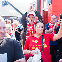 Anfield, Liverpool, UK. 15th April, 2014. On the 25th anniversary of the Hillsborough disaster fans cheer as the Hillsborough families pass by Anfield Stadium.